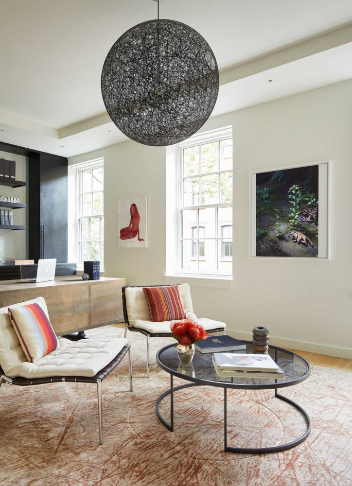townhouse interior design contemporary office with black globe light and cream chairs