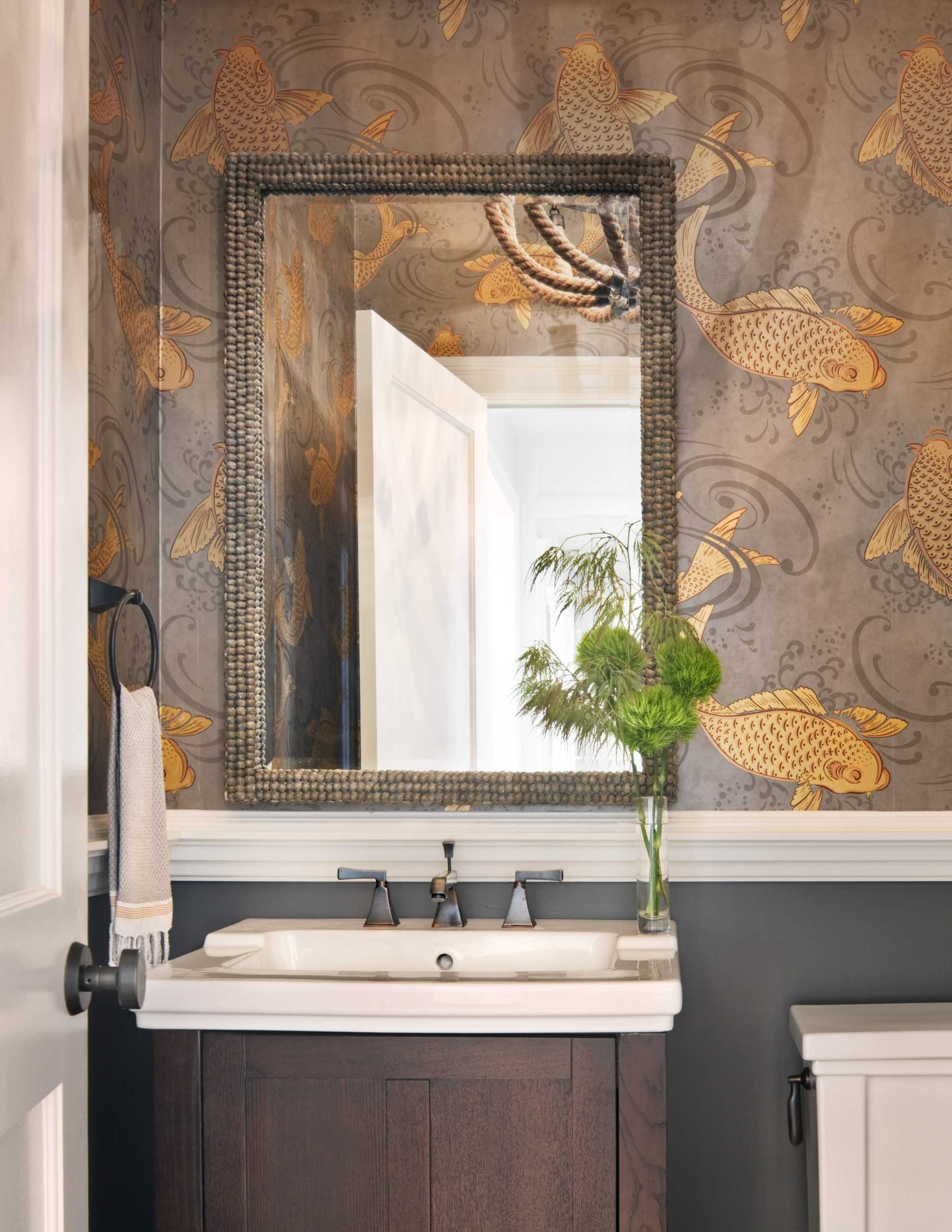 grey and gold fish wallpaper in powder room