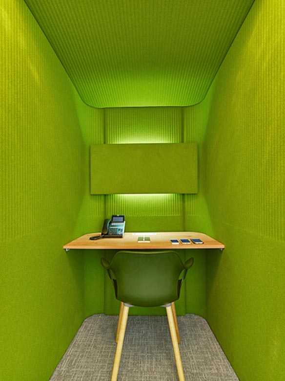 Green cheeky apple themed interior design for teacher's office green phone booth
