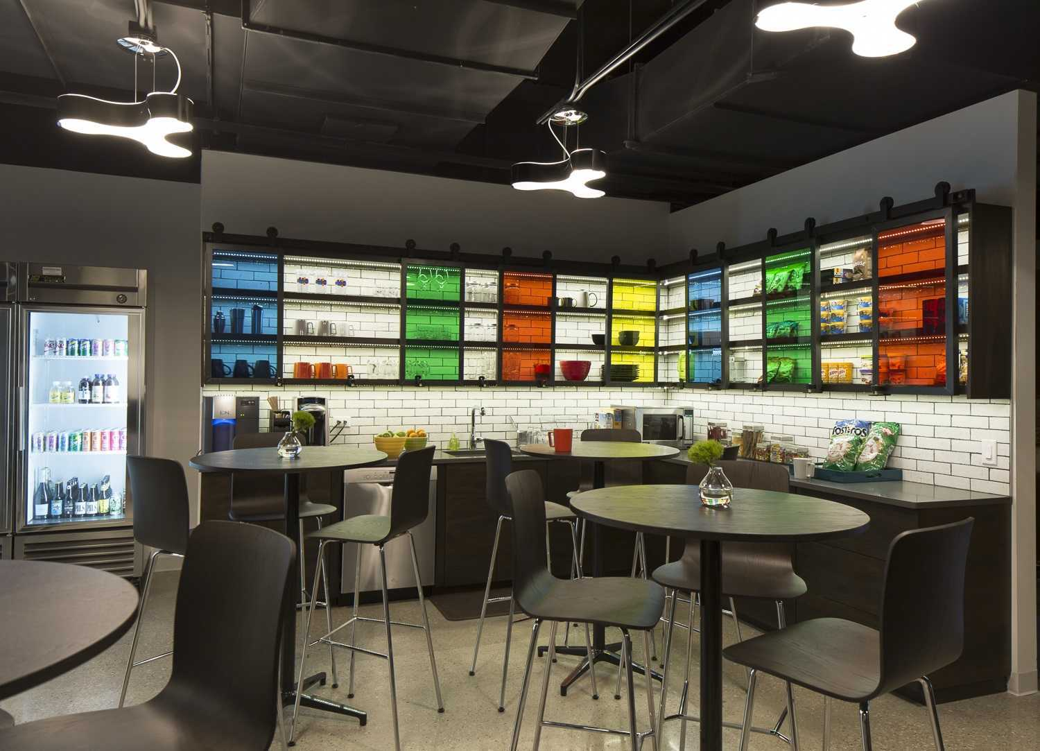 colorful break room with glass cabinets and seating