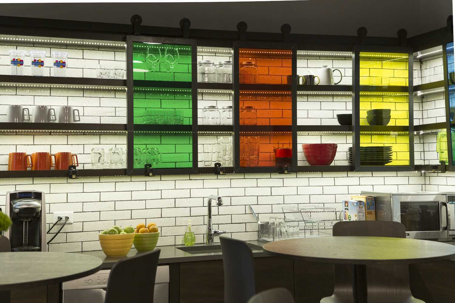 colorful break room with glass cabinets