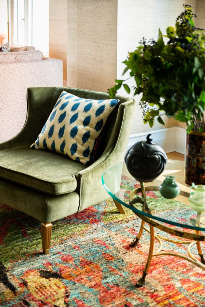 green chair on colorful rug