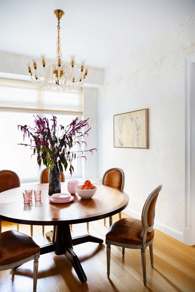 light dining room with chandelier and wood floors
