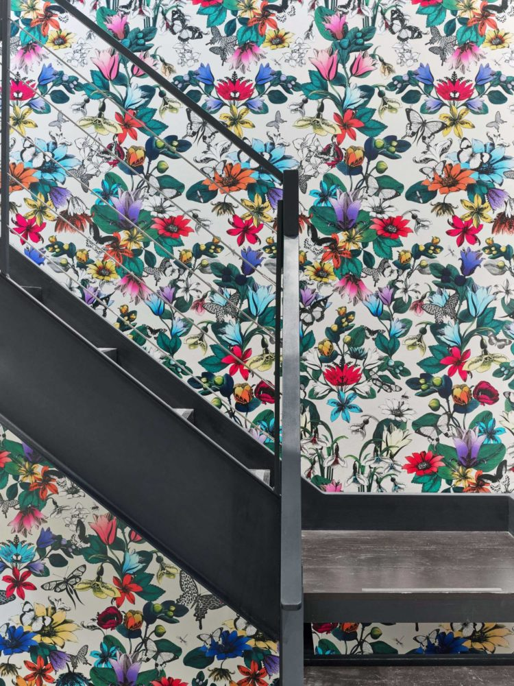 bright floral wallpaper on metal staircase