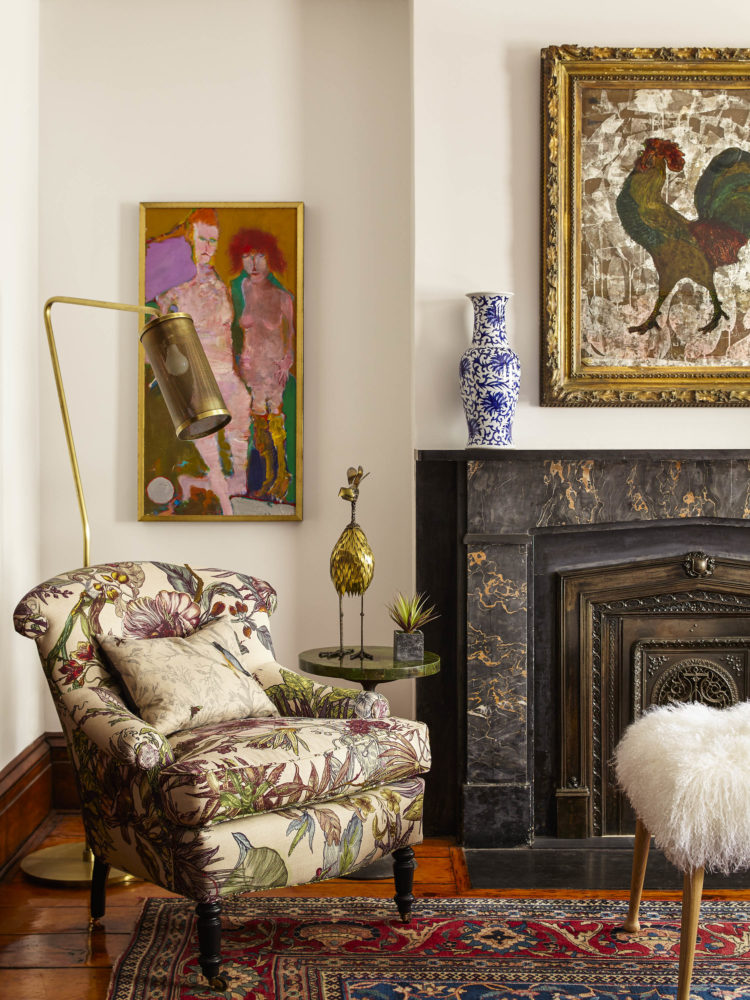 floral chair marble fireplace colorful art in manhattan townhouse