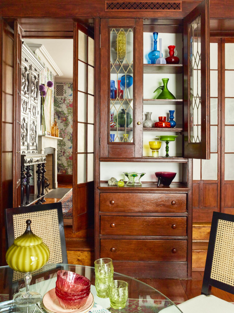 wood china cabinet with colorful glass pieces