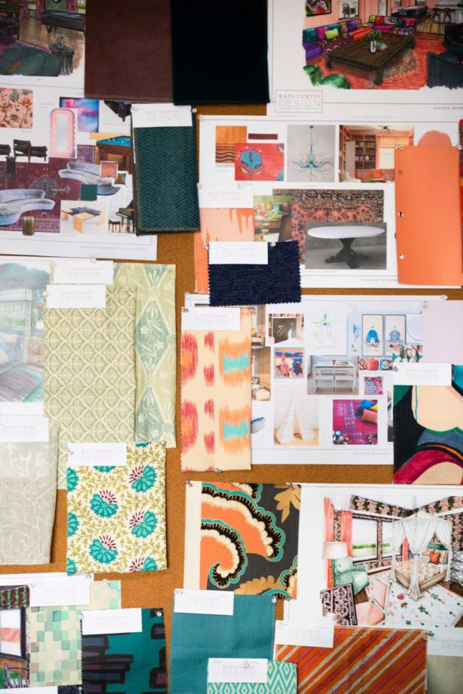 Colorful fabric swatches and interior design sketches on a corkboard
