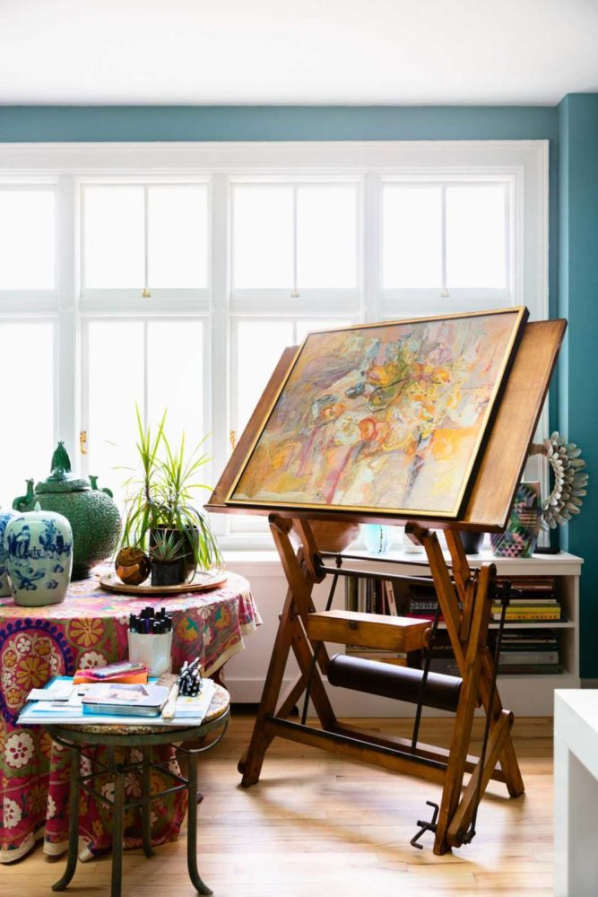 Sun drenched studio with colorful vintage easel