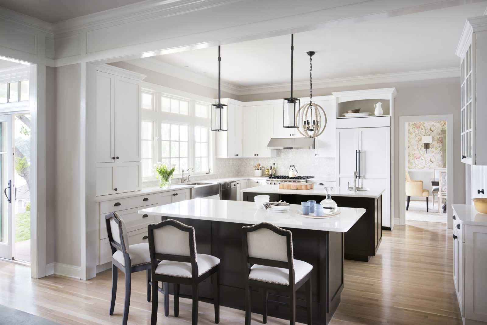 Large white kitchen with dark wood cabinets